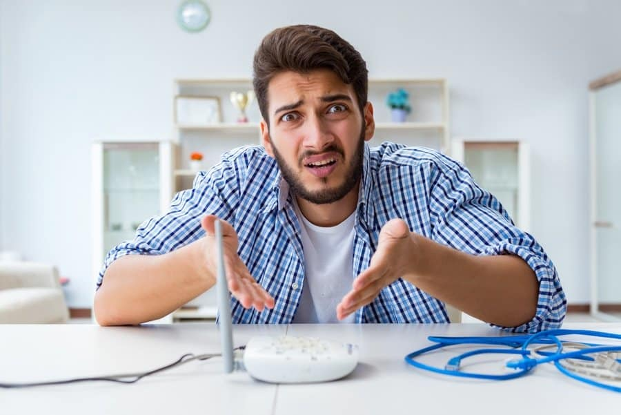 a frustrated man over bad internet connection