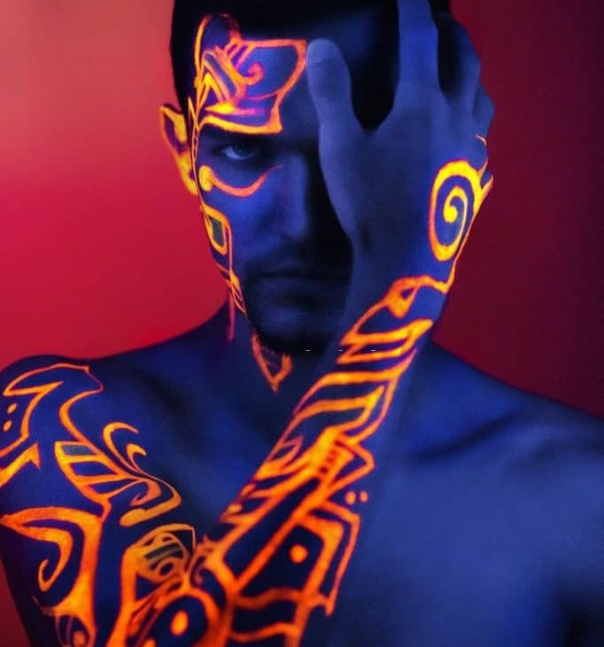 Person covered in glow in the dark body paint