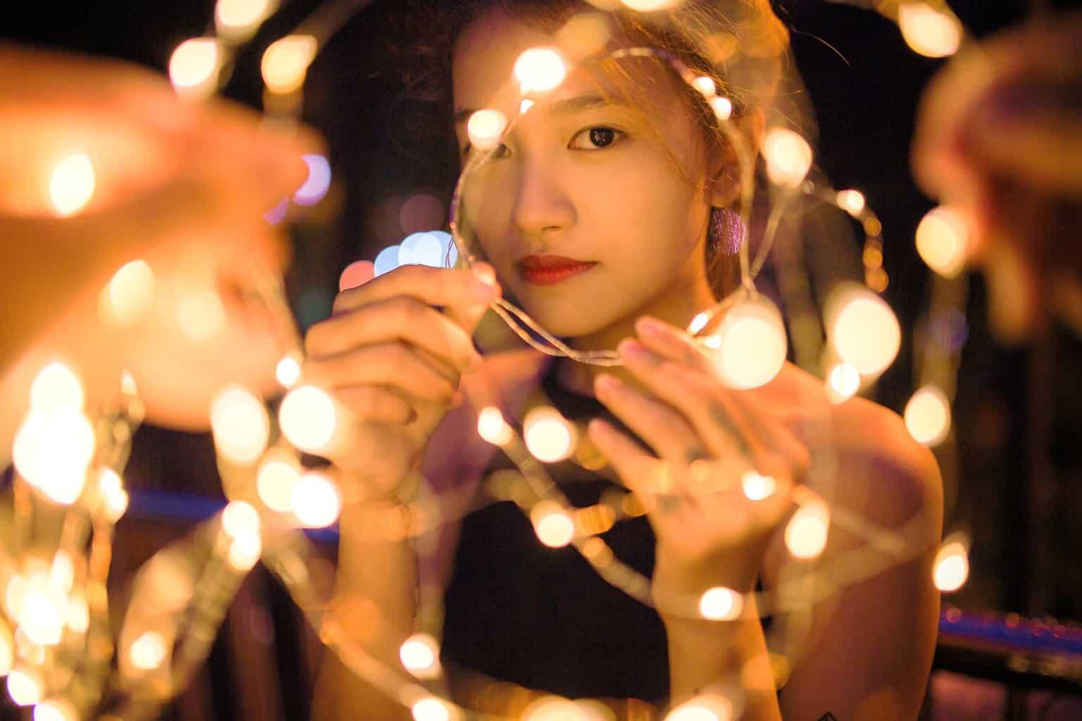 Woman wondering how long do led lights last on batteries