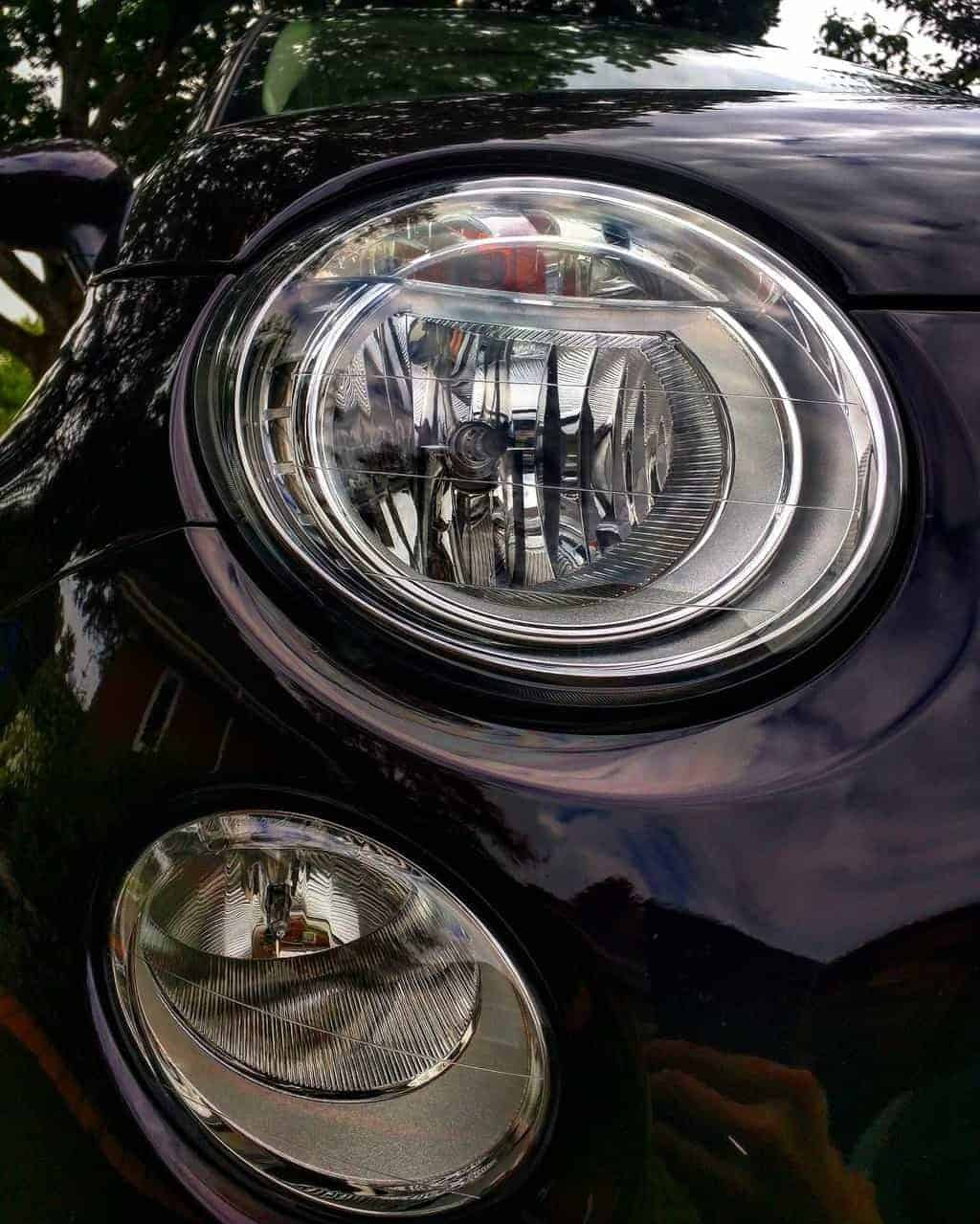 Close up of a car's projector headlights