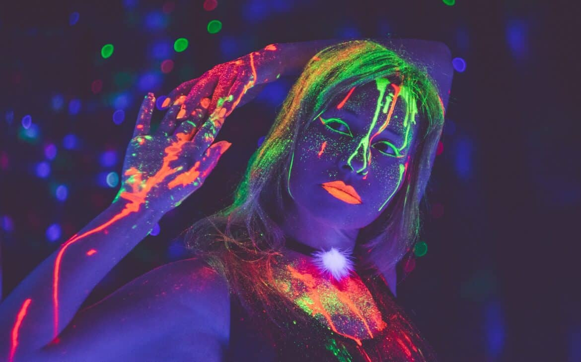 Woman wearing glow in the dark paint for a party