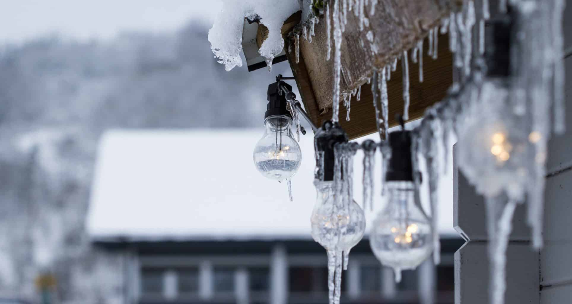 LED bulbs covered in frozen ice and cold weather