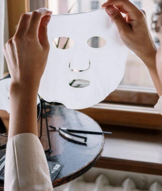Woman holding a facial mask
