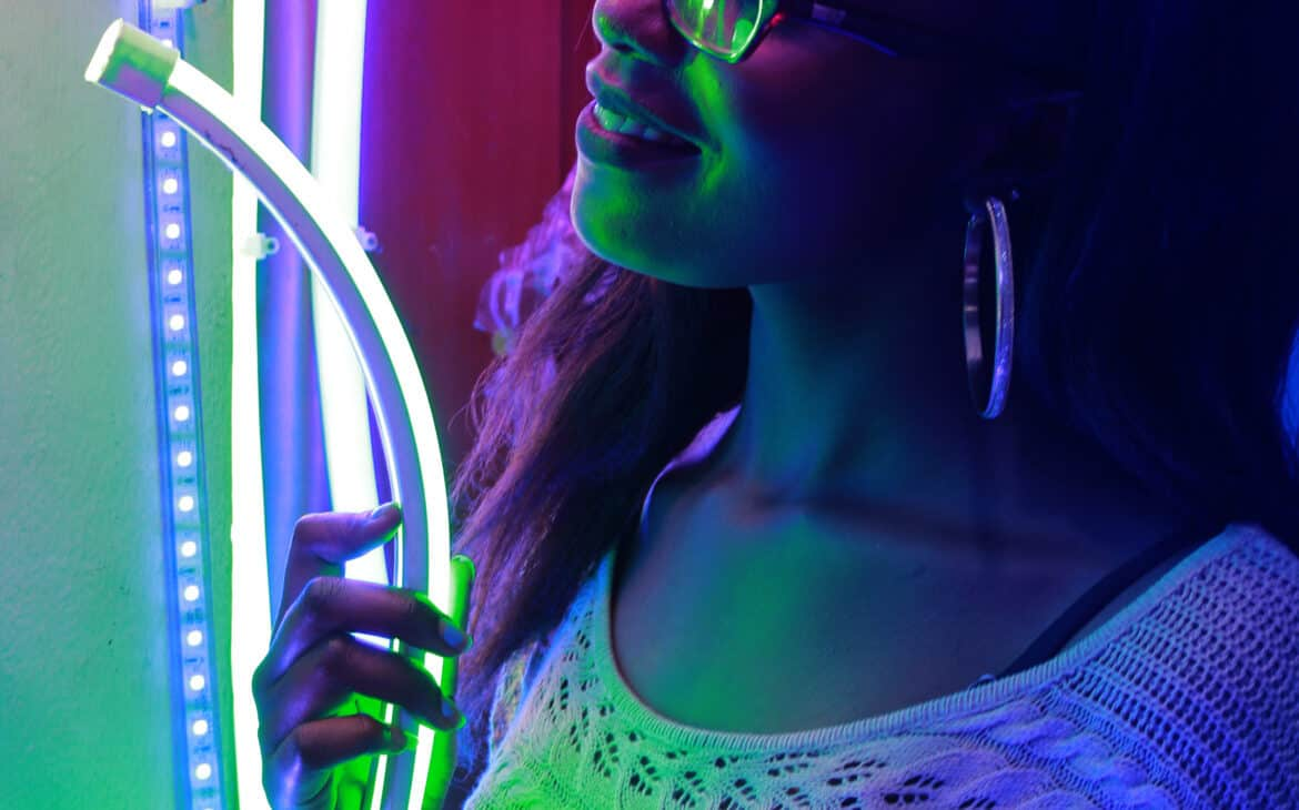 Woman resticking LED light strips