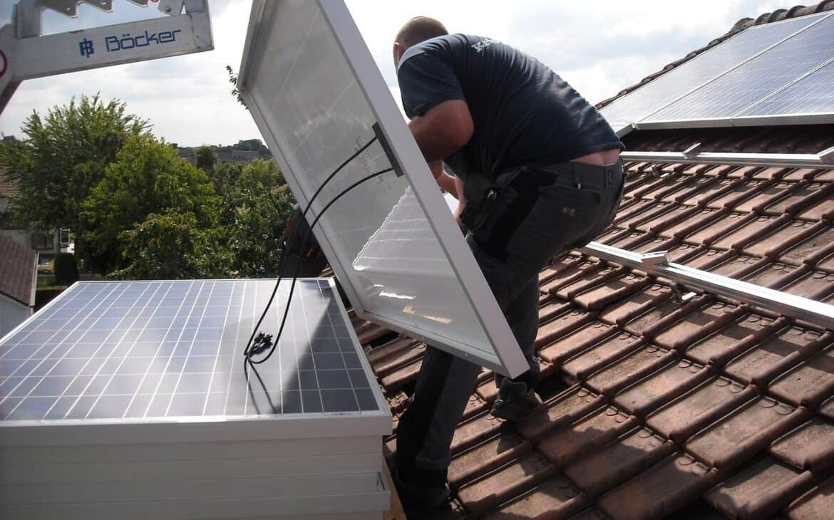 Man trying to install panel into solar panels