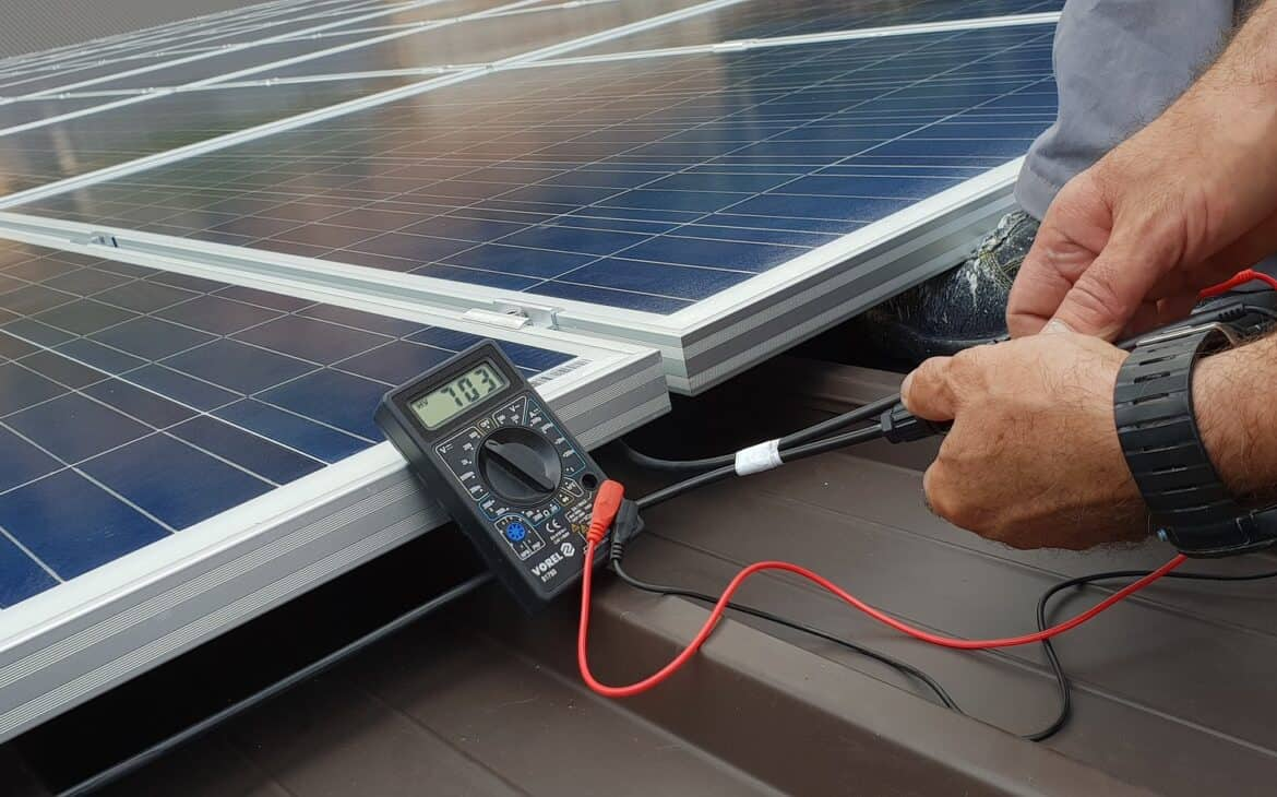 Person checking if LEDs can power solar panels