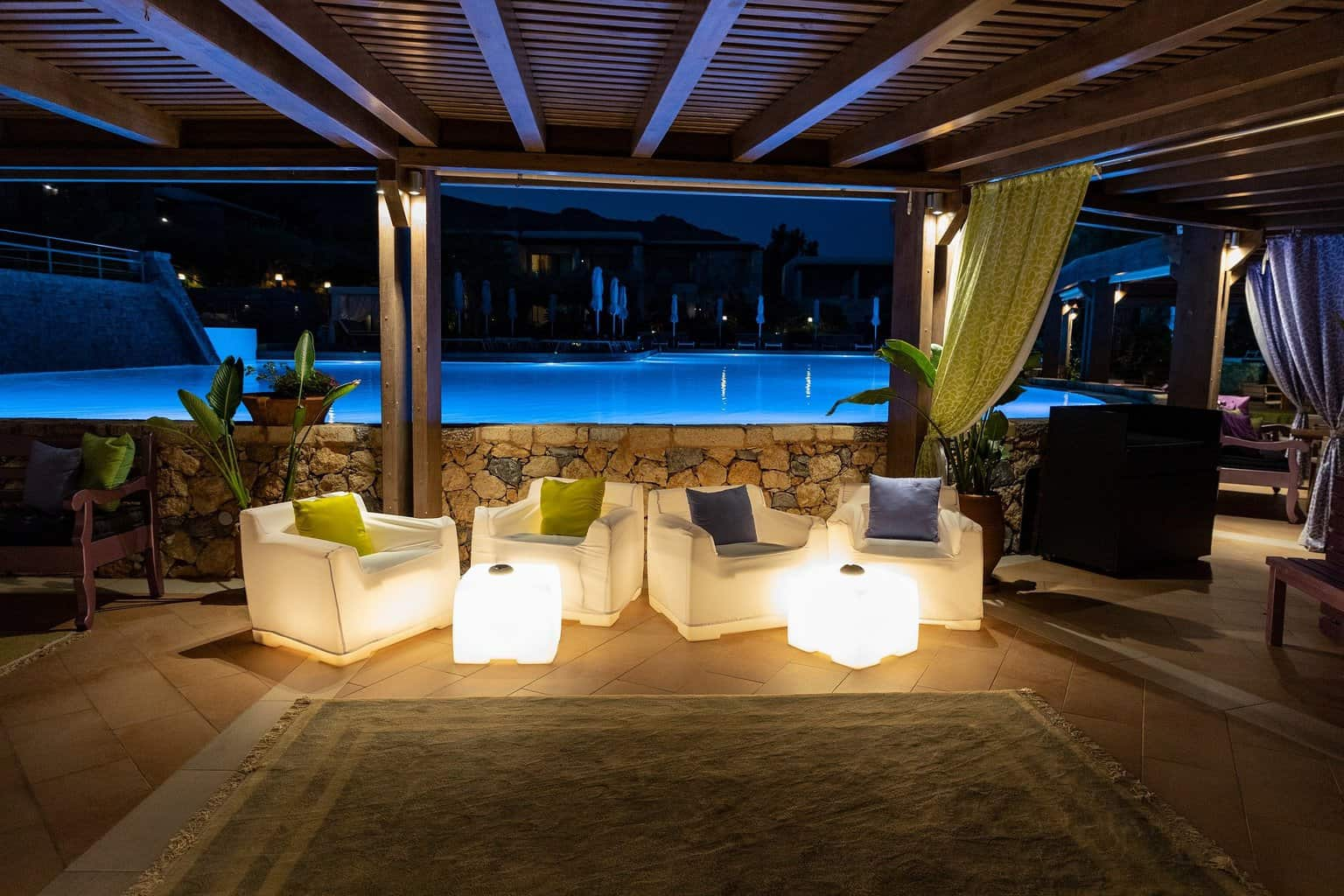Outdoor pool with LED light fixtures