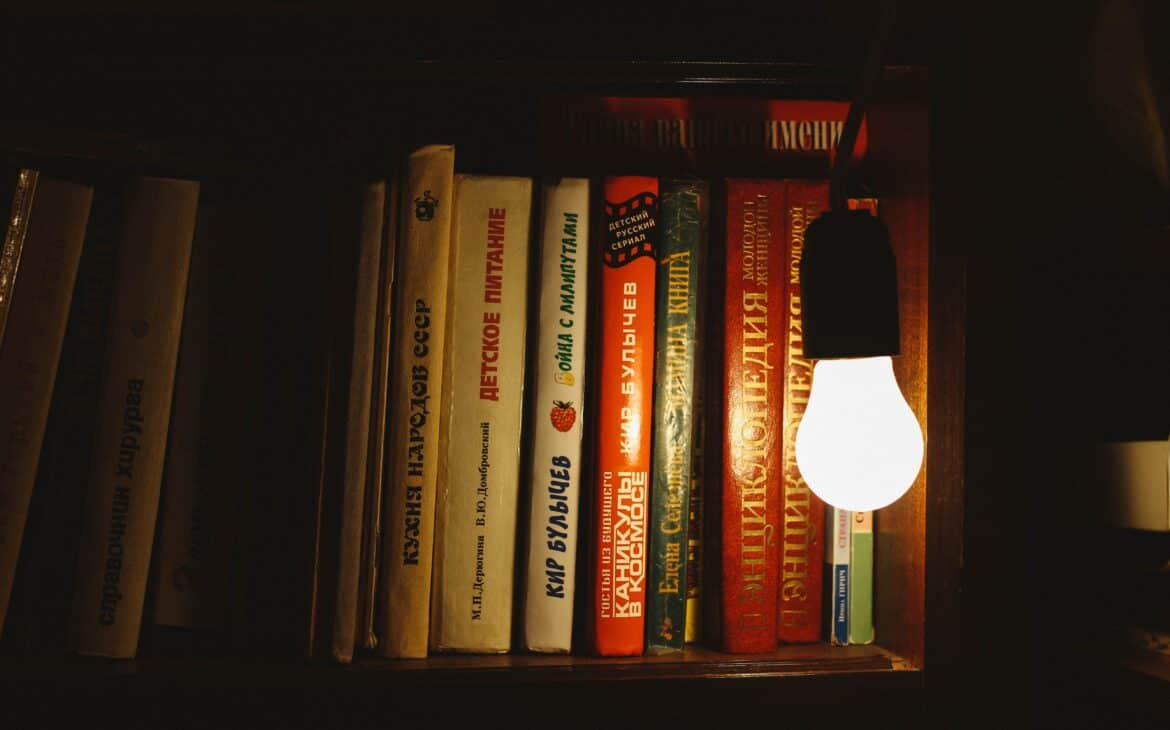 LED light bulb beside a bookcase
