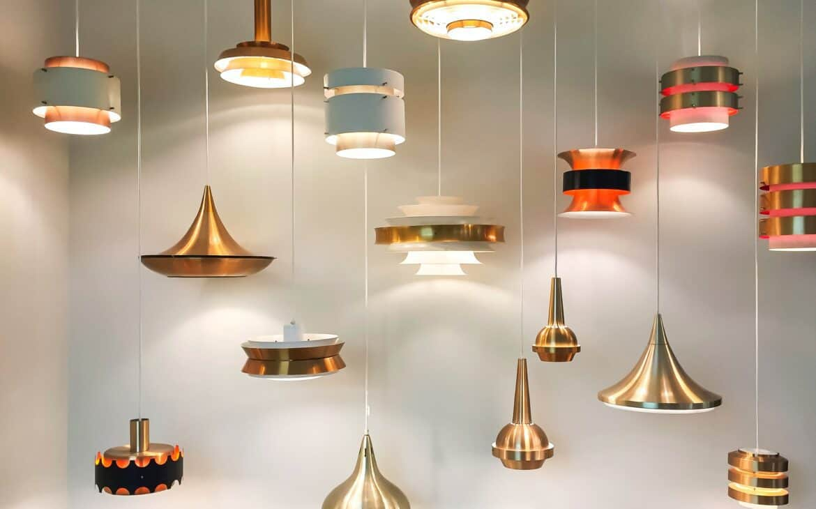 Gold and red pendant lamps hanging from ceiling