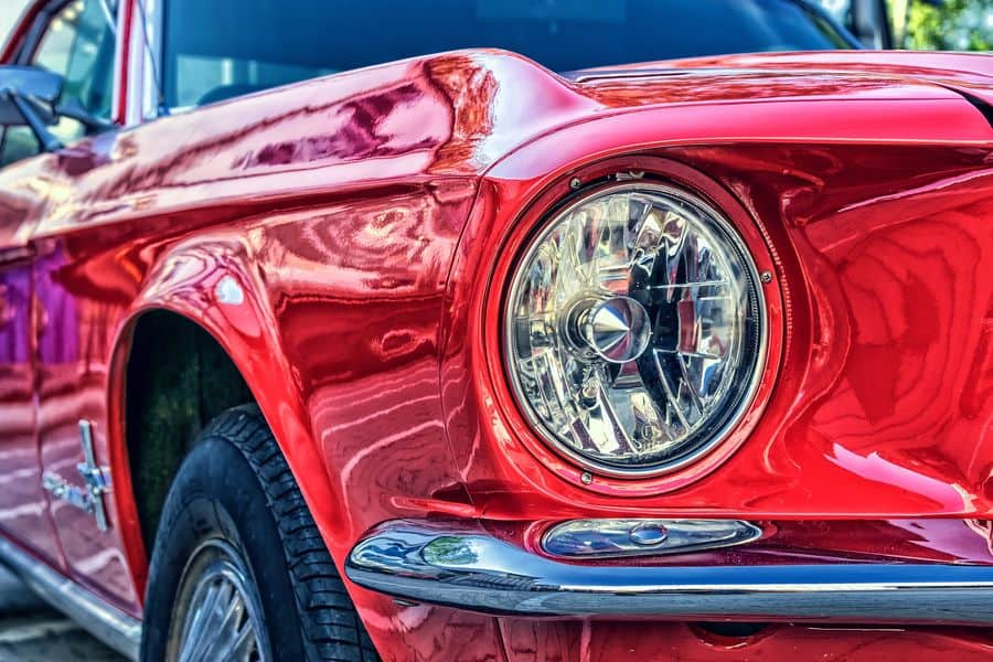 Red classic car with LED halogen projectors