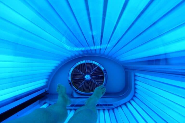 Lit tanning bed bulbs being used by a customer