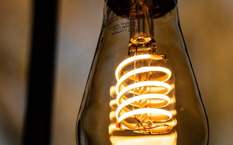 A close up shot of a downward LED bulb
