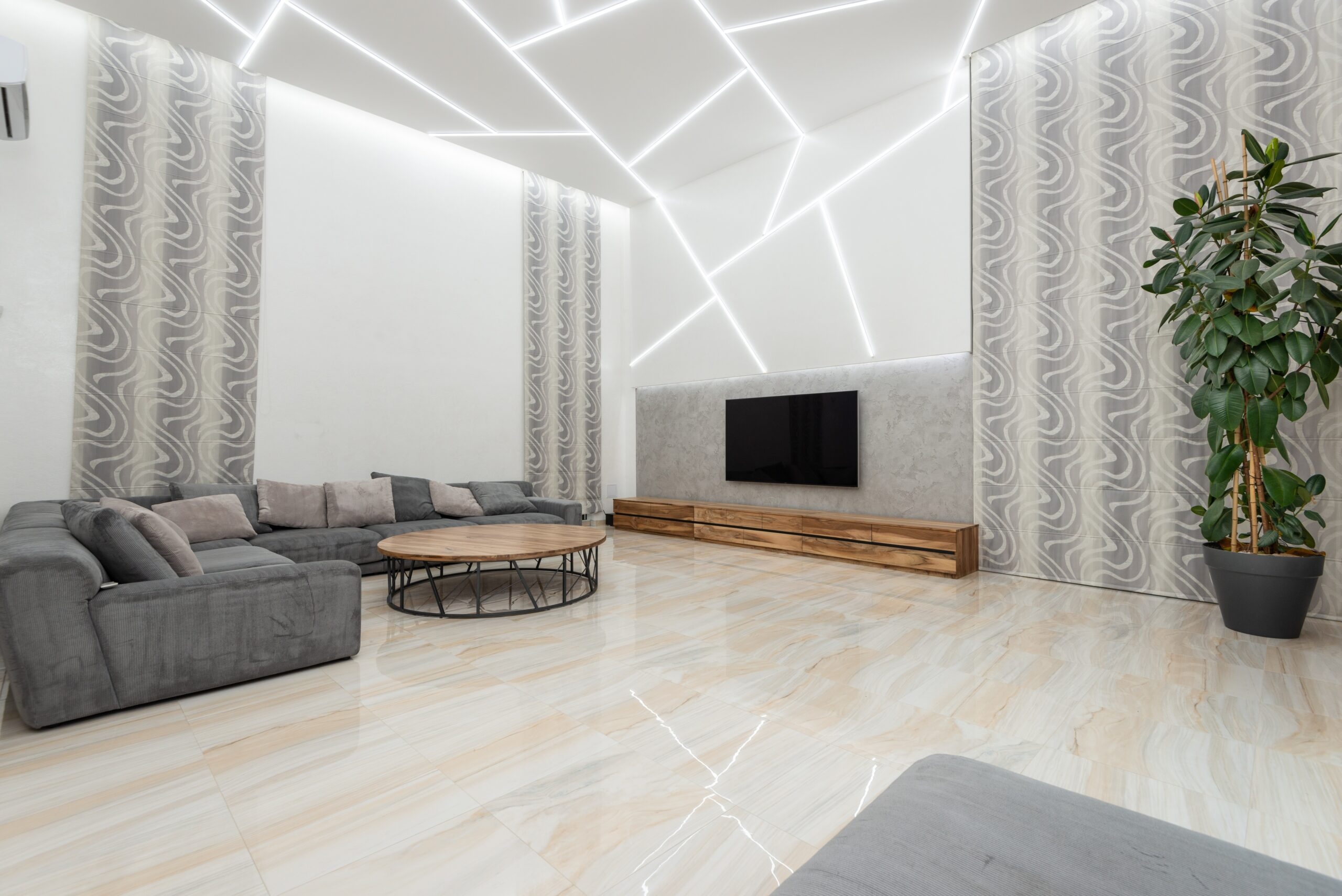 A living room with crooked pattern on ceiling with white lights